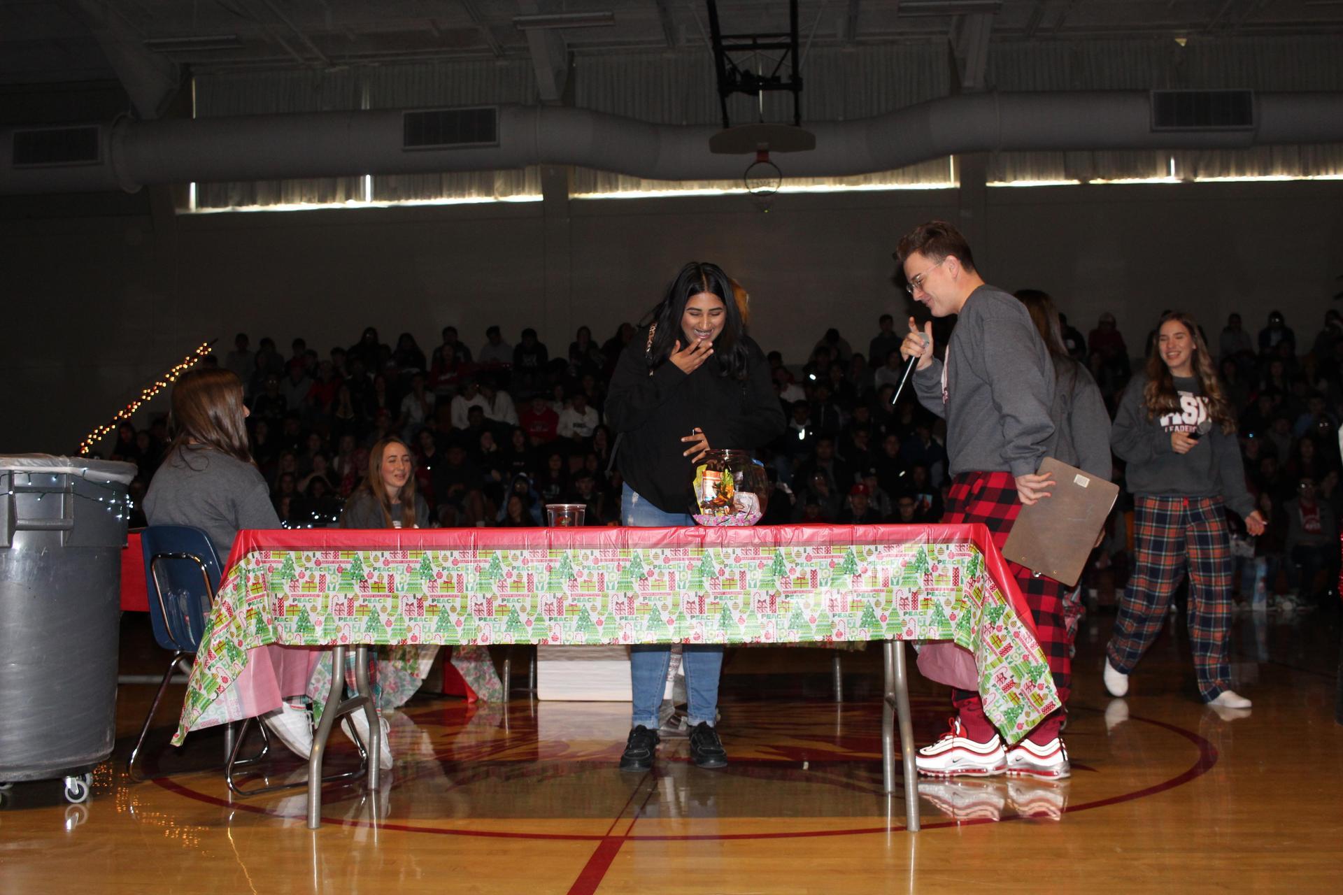 Muskan Johal  opening her gift