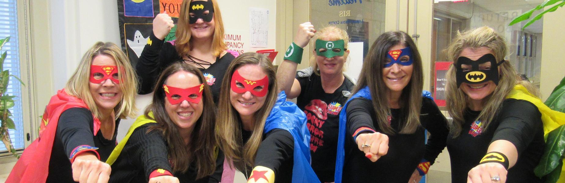 Photo of RIS staffers dressed as superheros for Halloween.