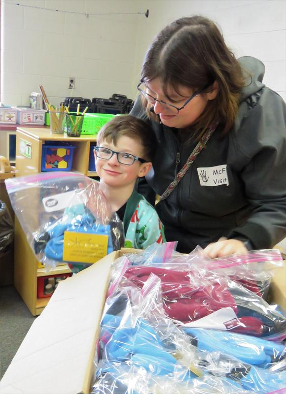 Zak and his mother, Theresa, prepare to deliver the homemade mittens.