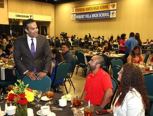Texas Land Commissioner George P. Bush (pictured left) talks with parents at the 2019 Top Ten Percent Honor Banquet at the McAllen Convention Center.