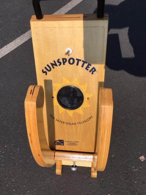 wood and glass solar eclipse viewing prop on pavement