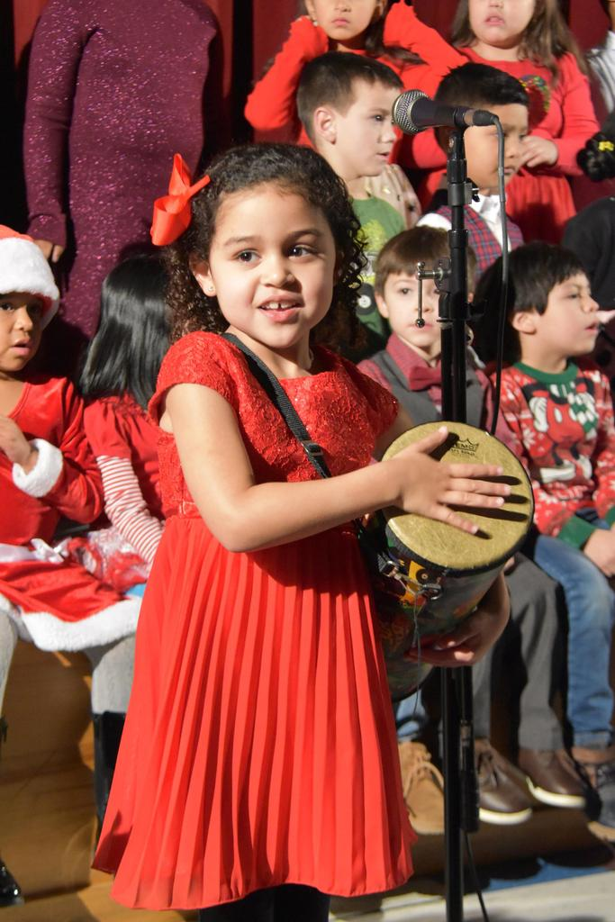 A girl plays the tambourine