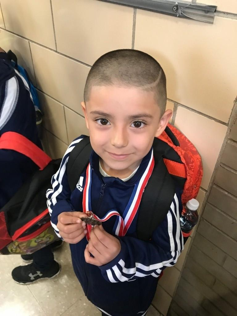 Kinder student with his medal