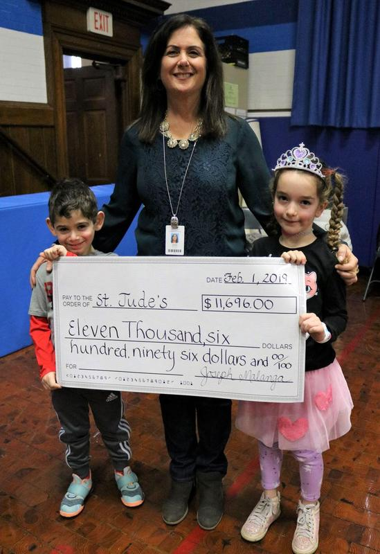 """The Wilson School community raised $11,696 for St. Jude Children's Research Hospital during the school's """"Month of Hope"""" in January.  Pictured here with Wilson 1st grade teacher Marie Morris are two of her students Jonah Diamant and Devlin Rowan"""