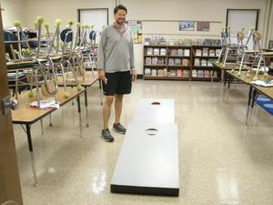 Mr. Ware has a cornhole game set up.