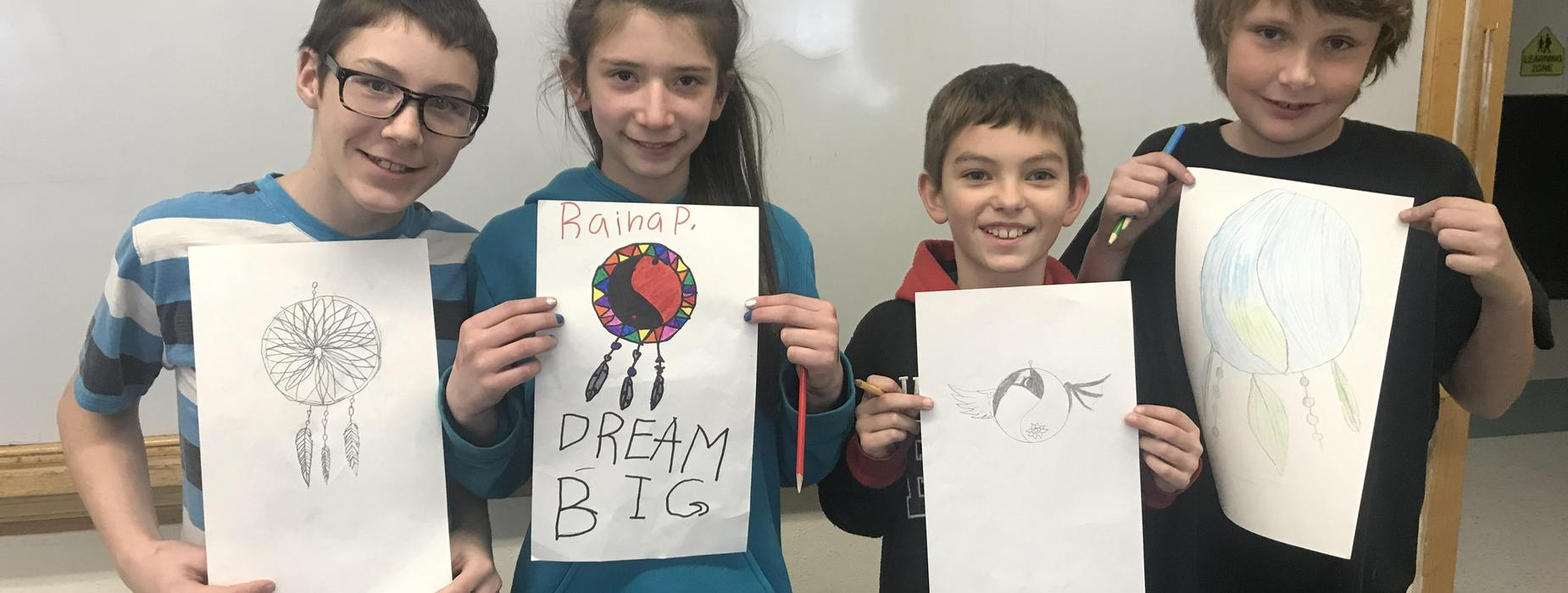 Students with their artwork.
