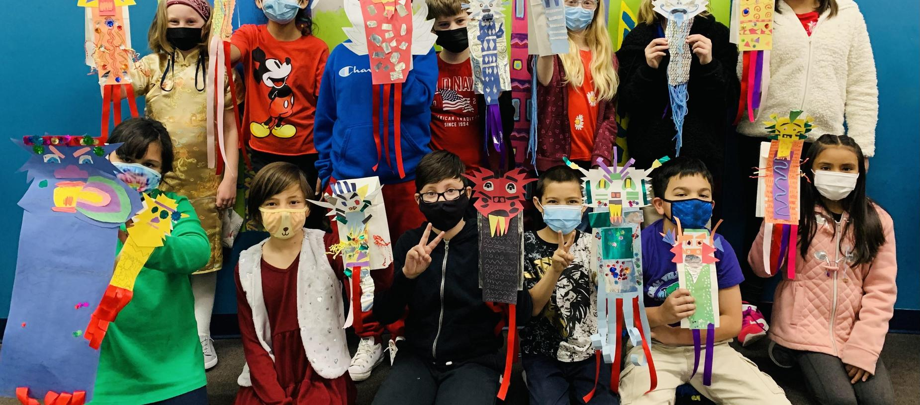 Students Showing off their Dragon Art Project for Chinese New Year!