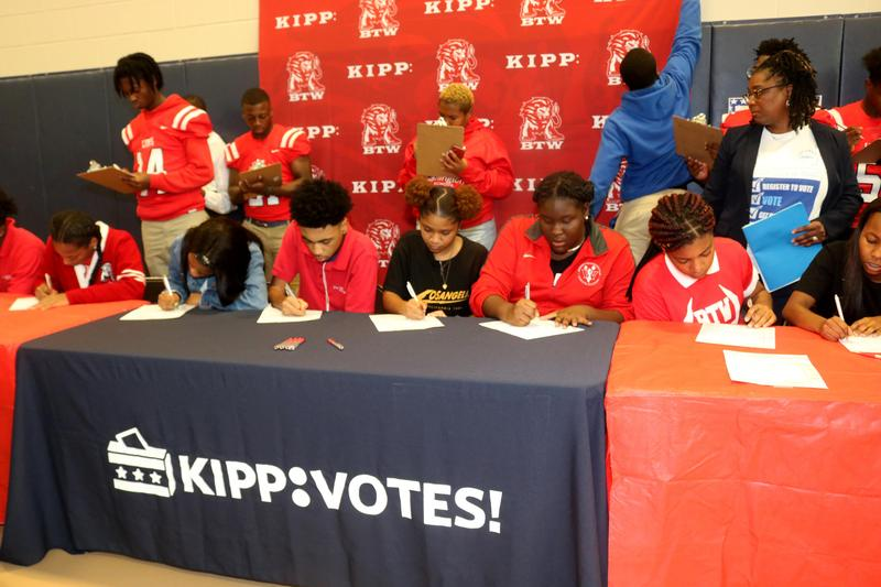 Students at KBTW filling out voter registration forms
