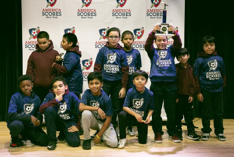 Boys holding up trophy after winning spirit award