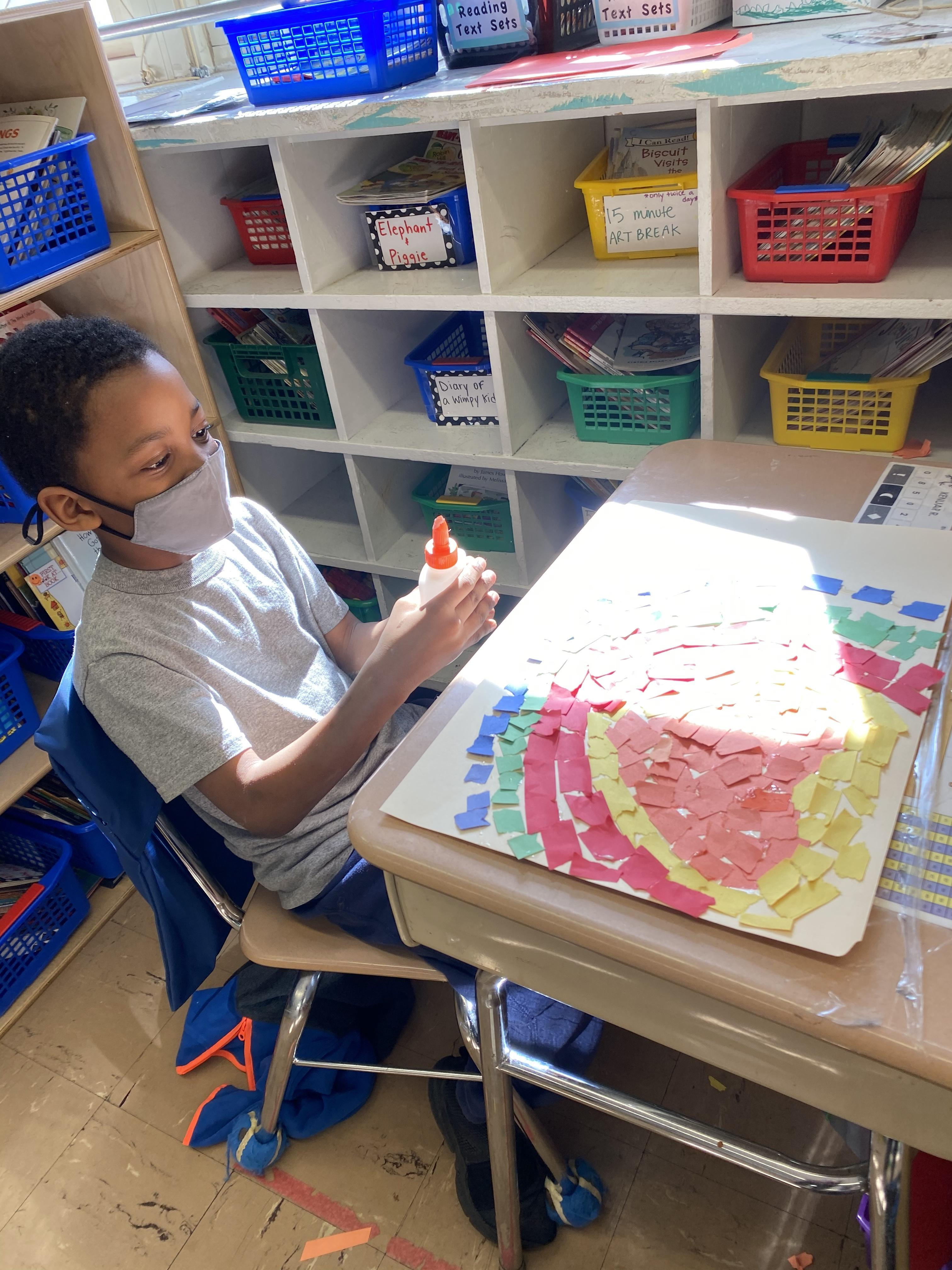 boy working on mosaic project