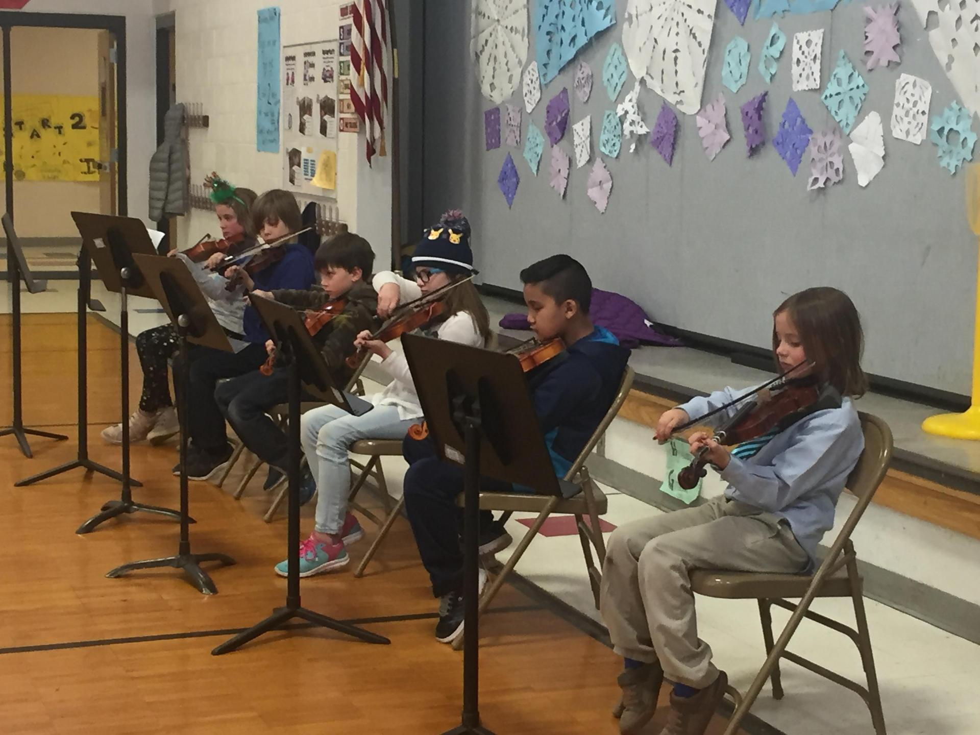 Students in orchestra.