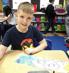 Photo of student using watercolors to paint a Chinese dragon during Franklin School's