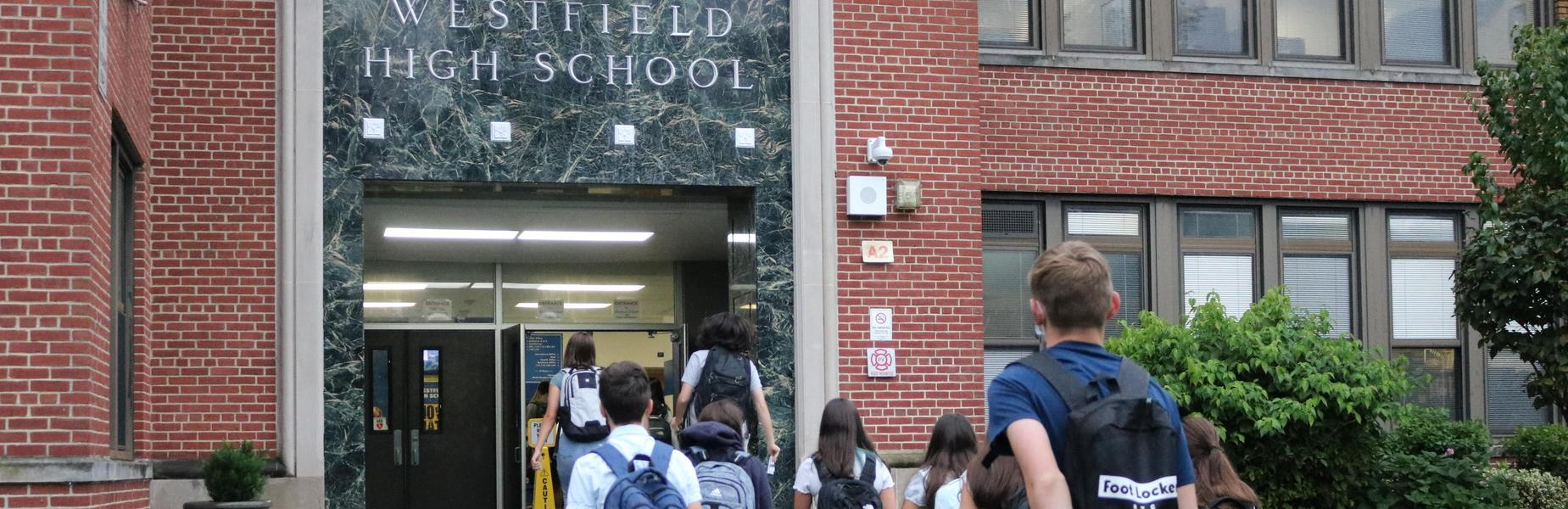 Photo of high school students entering building on first day of school