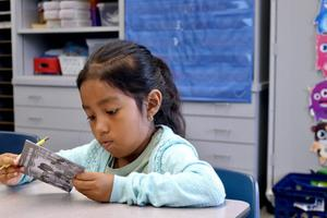 Dual Immersion student reading a book