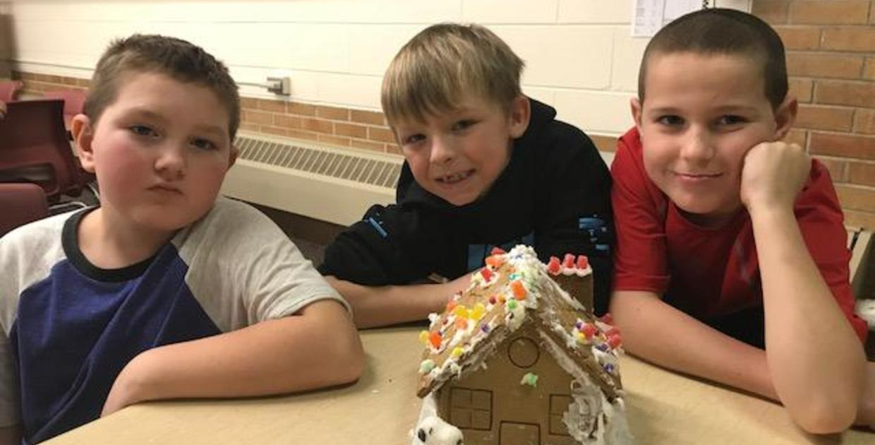 Mrs. Hansen's second grade class making gingerbread houses.