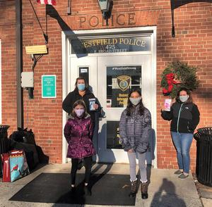 Jefferson students Abigail Drennan and Kayla Kowalak and parents deliver masks and homemade lanyards to Westfield Police Department.