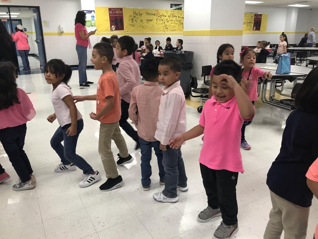 young kids dancing to support cancer awareness