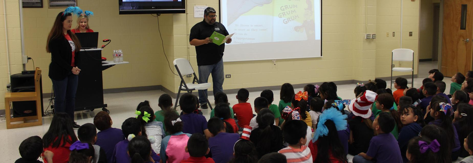 Board member reads to students