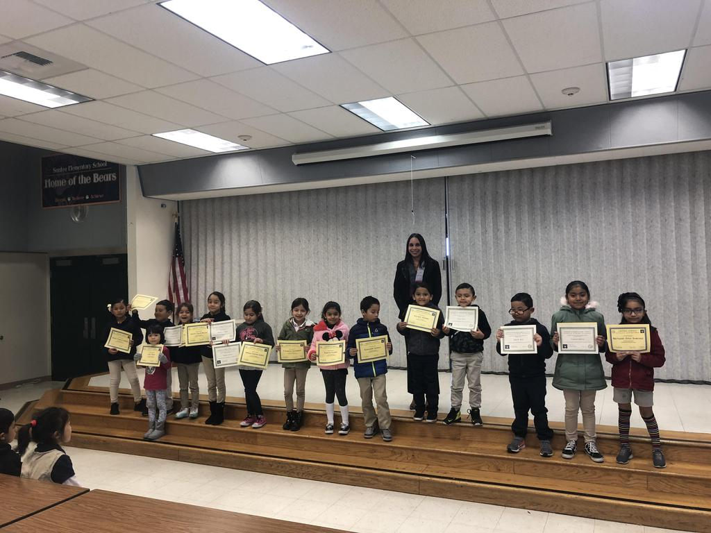 trimester one award winners in Ms. Orozco's class pose for picture