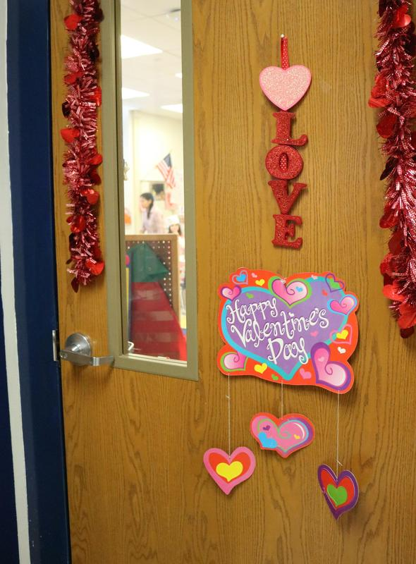 Photo of door exterior decorated for Valentine's Day.