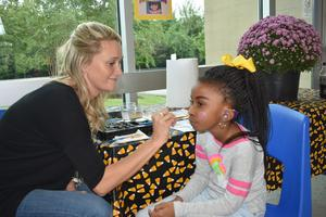 WTSD - Fall Festival - student being face-painted