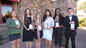 Students of the Month from Hemet and San Jacinto standing with their plaques.