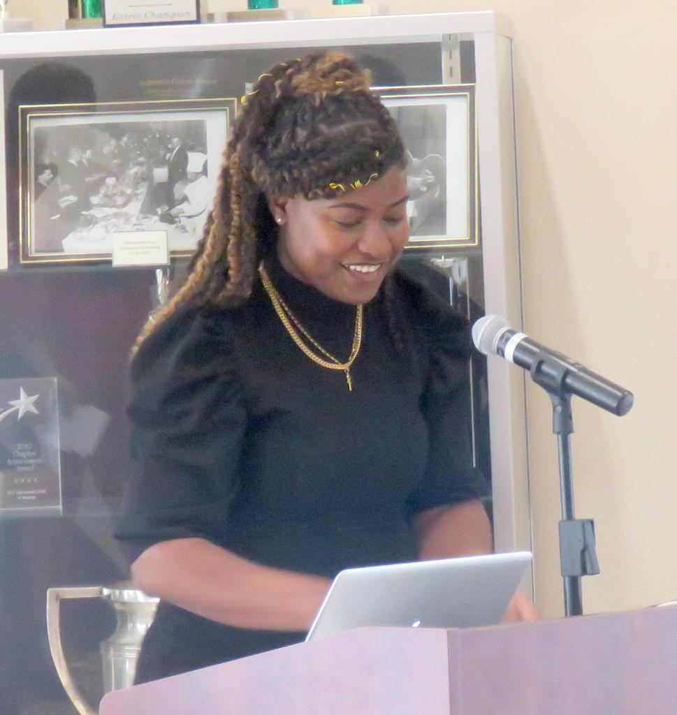 A student at a podium
