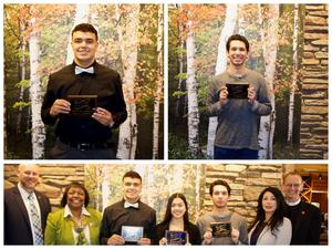 Students of the Month holding their plaques