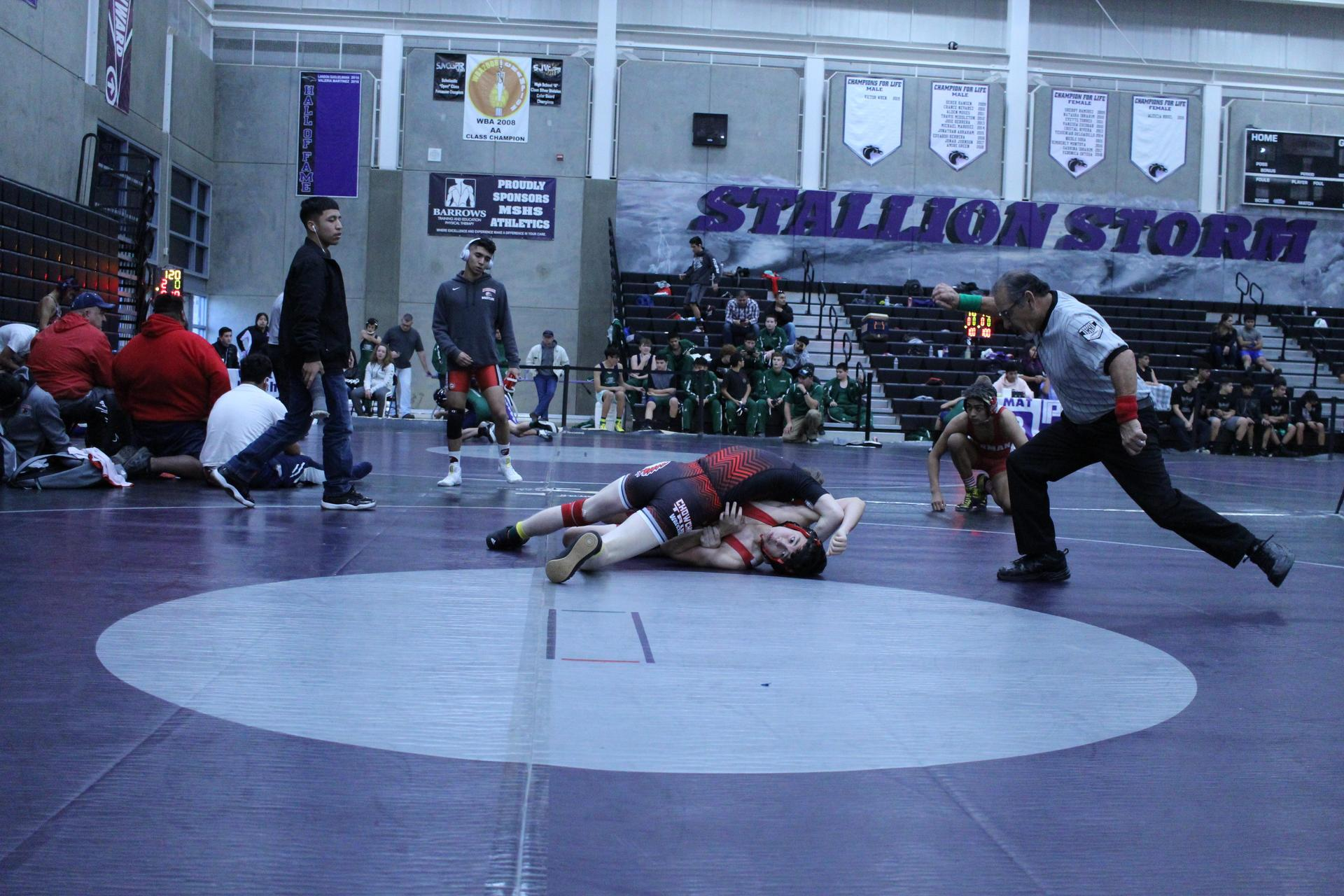 wrestlers in action at madera high
