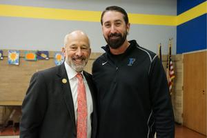 mayor dan pope poses for a photo with coach chad reynolds