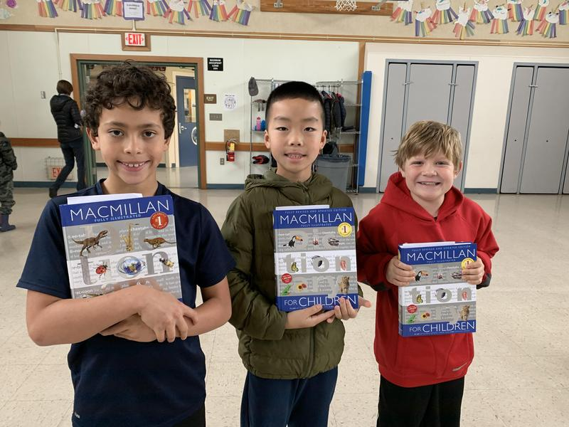 three boys with new dictionaries