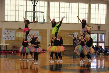 MJHS Cheerleaders performing a stunt routine during a pep rally.