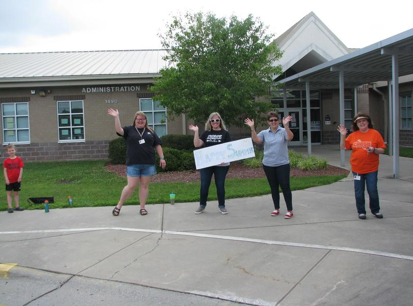 Friendship staff and students saying good bye for summer break during our Student Parade