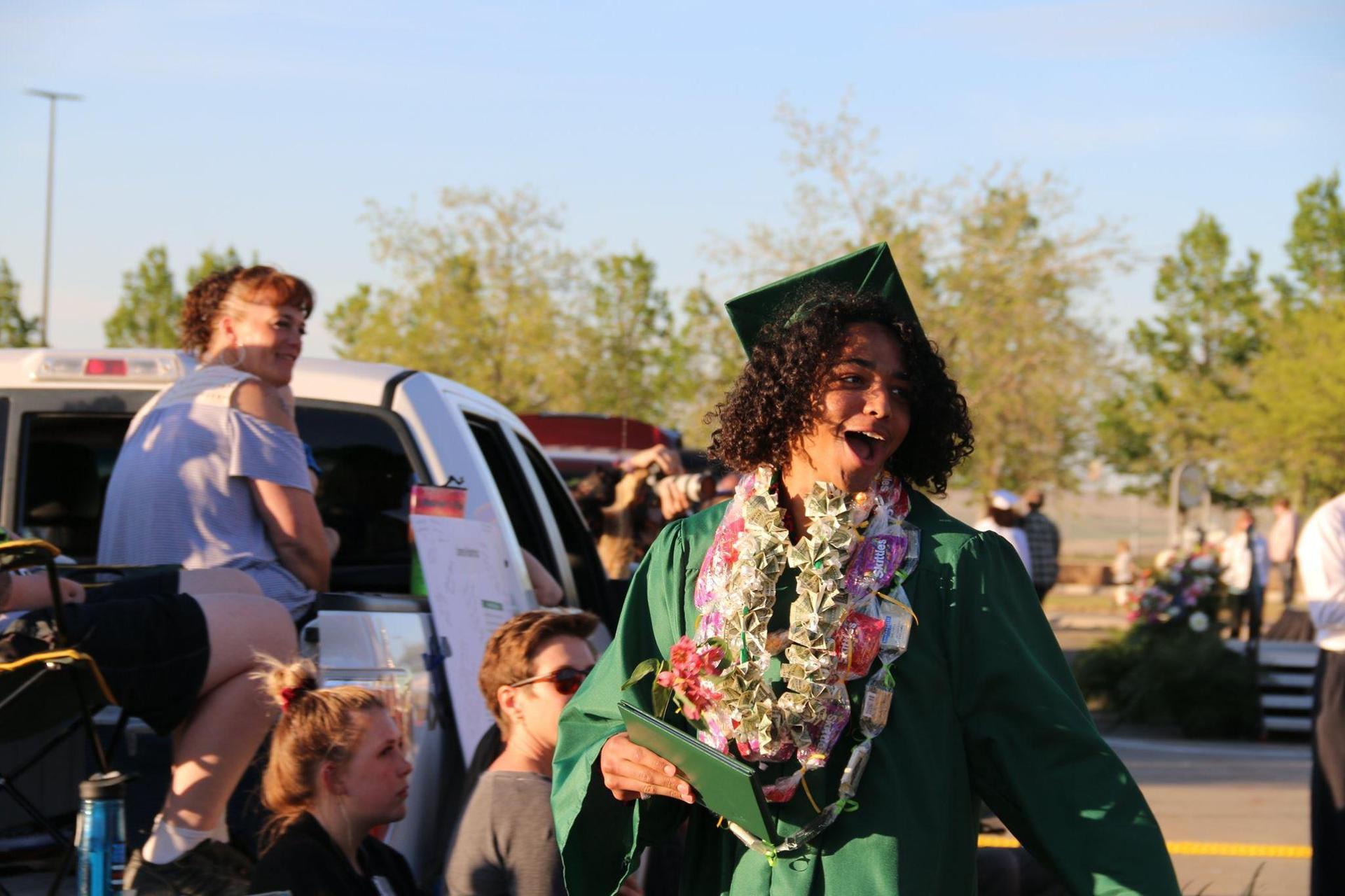 Boy walking at High School Graduation