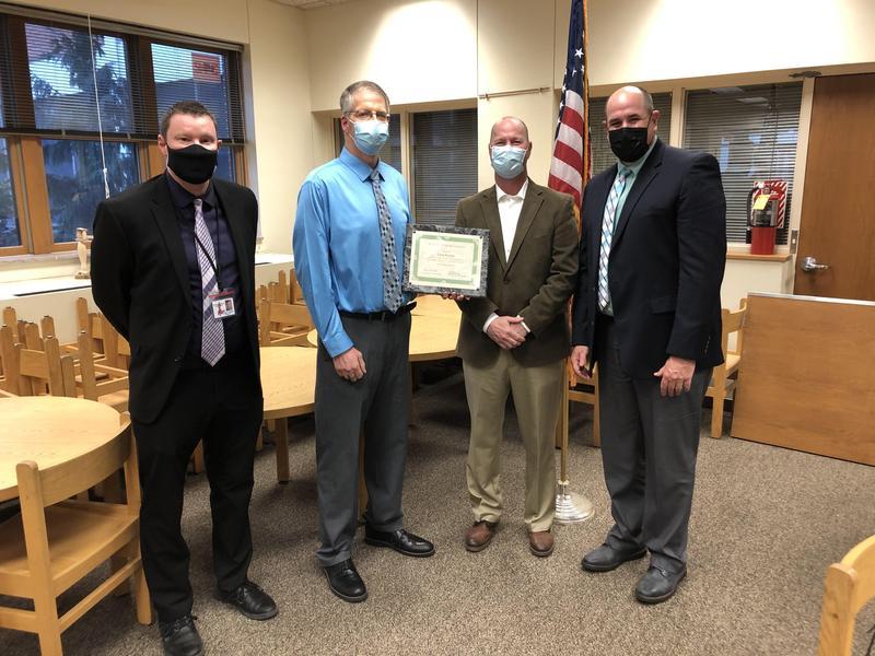 Image of Mr. Kaylor receiving an award.