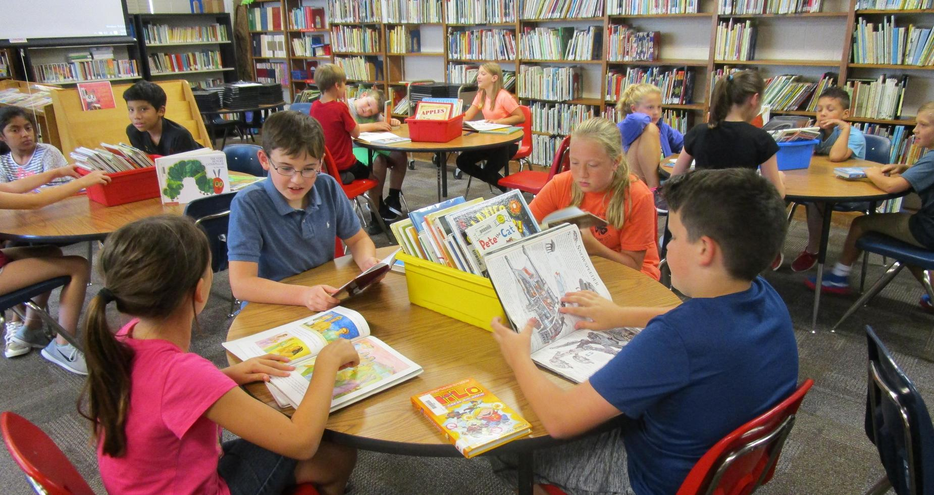 Fifth graders reading in the library