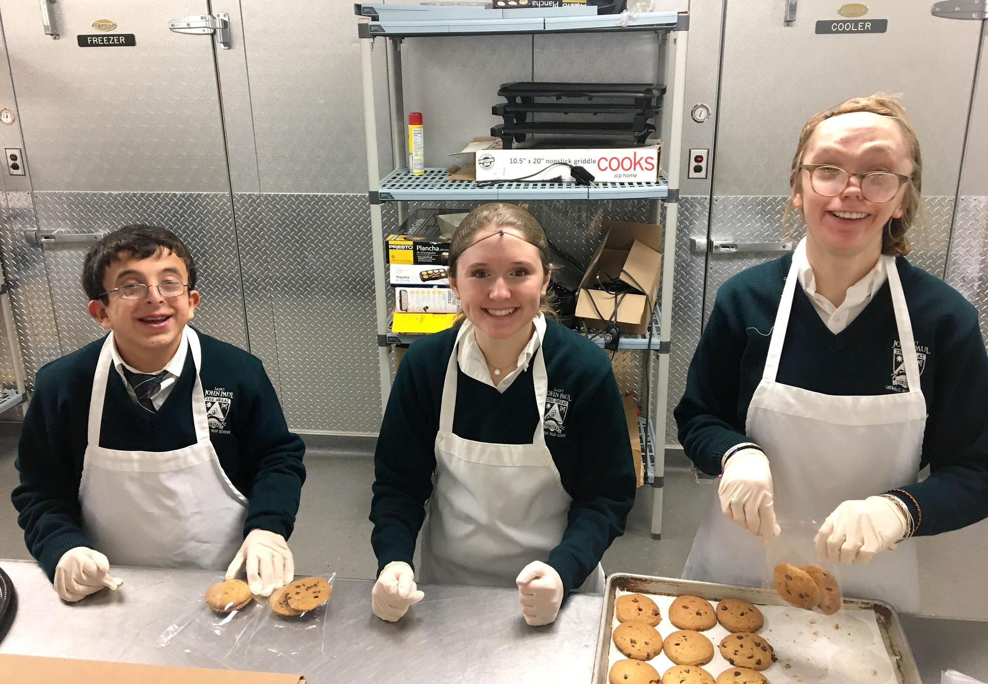 Options students cooking in the kitchen