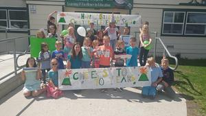 Nicole Crowthers Class w/ CES 70th Birthday Sign