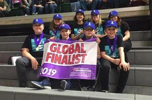 Alamo DI team with Global Finals sign in front of them.