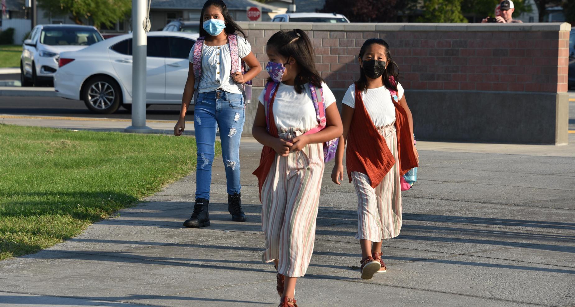Twin sisters walking to school.