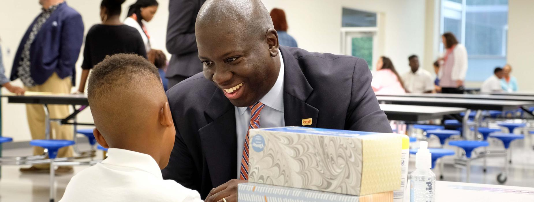 Superintendent Earnest Winston greets a student