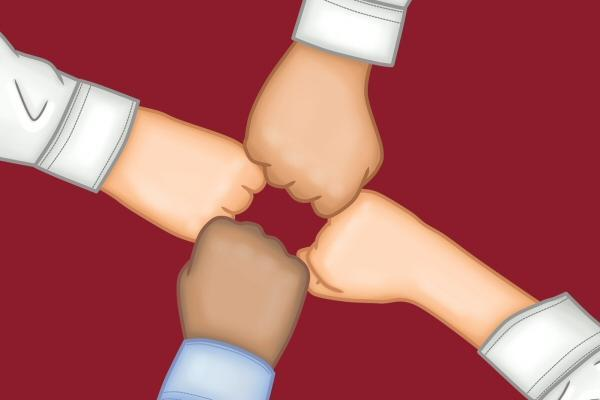 Four person fist-bump; people working together