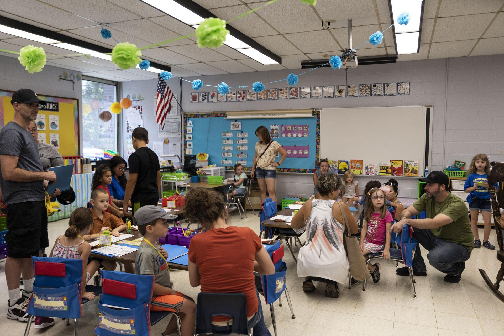 Students and parents in classroom