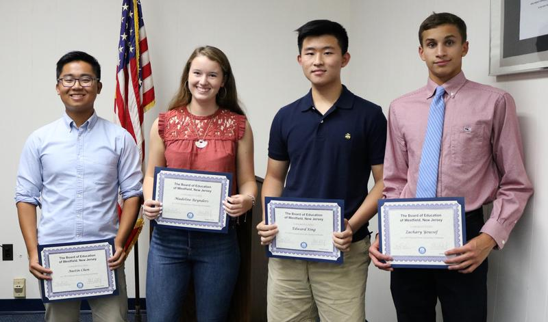 Westfield High School seniors Austin Chen, Madeline Reynders, Edward Xing, and Zachary Youssef receive congratulatory certificates at the Oct 9 Board of Education meeting as semifinalists in the 2019 National Merit Scholarship Program.