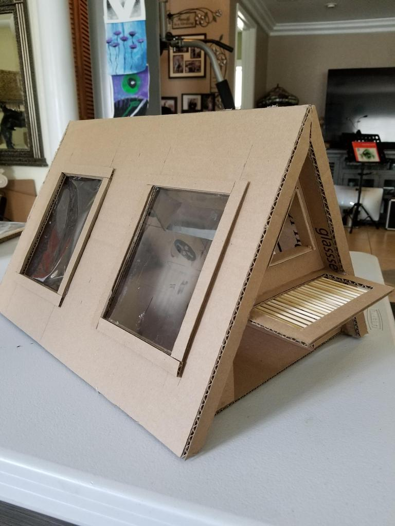 A framed house made out of cardboard
