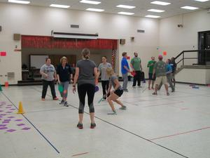 Elementary PE teachers playing a game.