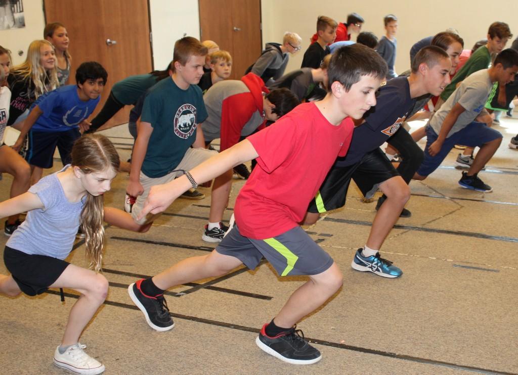 Middle schoolers practice line dances in PE.