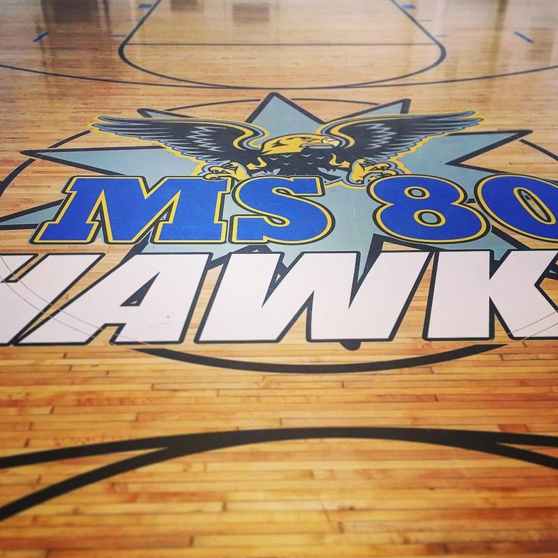 HArdwood basketball floor with logo