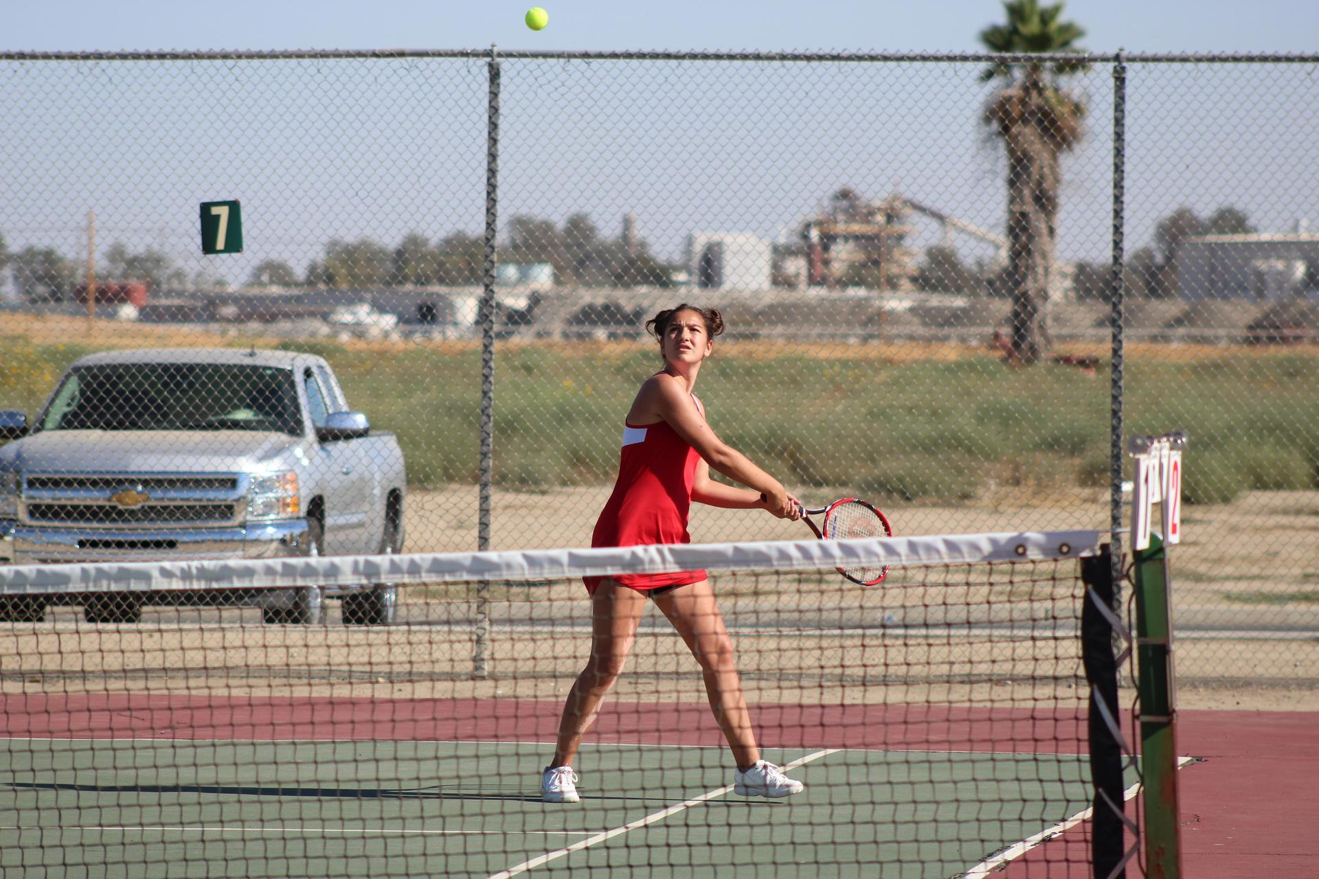 Girls playing tennis against Washington Union