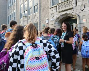 Roosevelt Intermediate School principal Mary Asfendis greets students during first week of school.